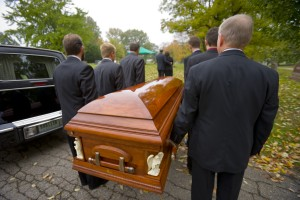 Carrying-casket-to-grave-300x200